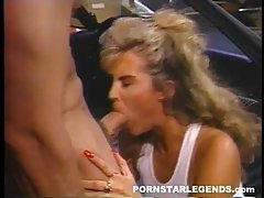 Peter North is fucking a smoking hot, blonde slut in his car, in front of her house